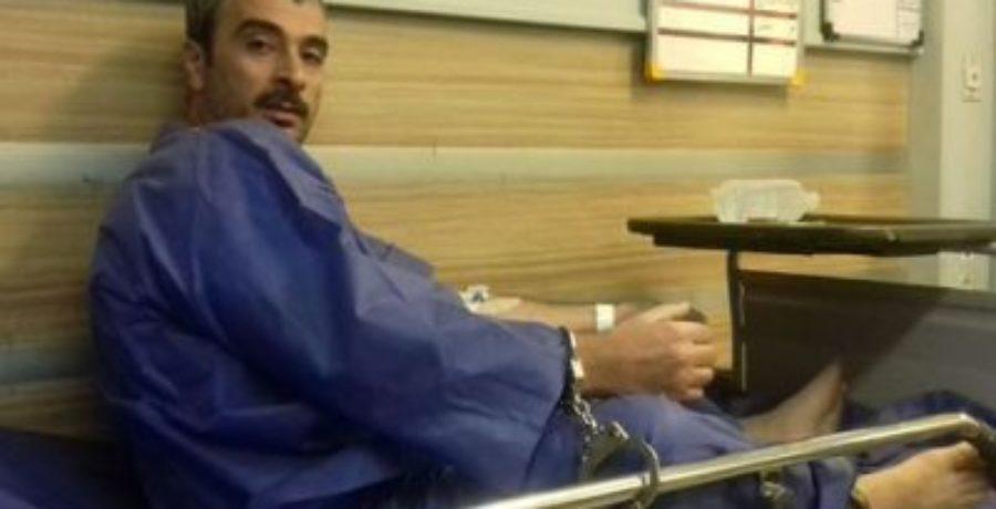 ضرب و شتم زندانی سیاسی در حال اعتصاب غذا مقابل همسر و فرزندش در بیمارستان