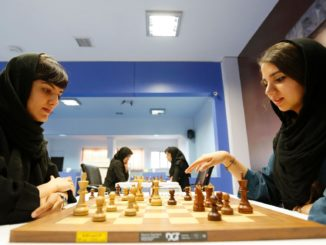 Iranian women take part in a chess tournament in Tehran last October. Dorsa Derakhshani was banned from playing for Iran for not wearing a hijab. Photograph: Atta Kenare/AFP/Getty Images